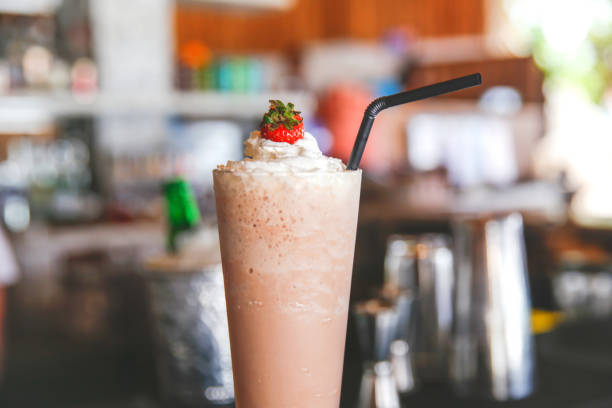 chocolate smoothie with whipped cream and strawberry on top - low carb shakes stock-fotos und bilder