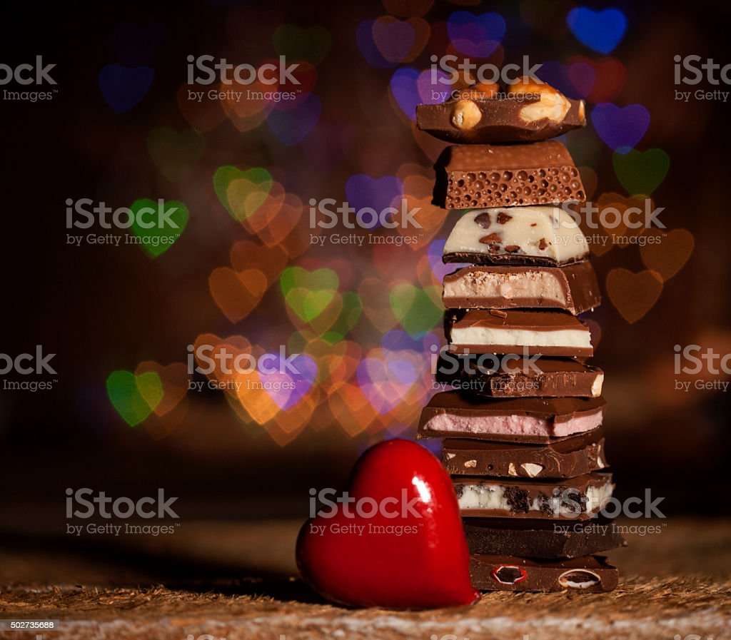 Chocolate stack on colorful bokeh background stock photo