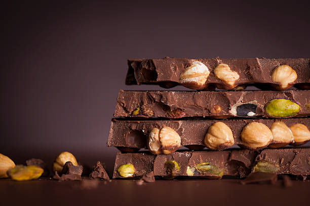 Chocolate Stack with nuts and pistachios stock photo
