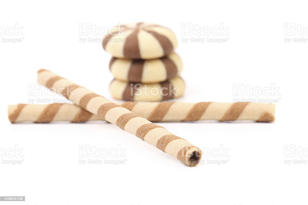 Chocolate striped wafer rolls and stake biscuits. royalty-free stock photo
