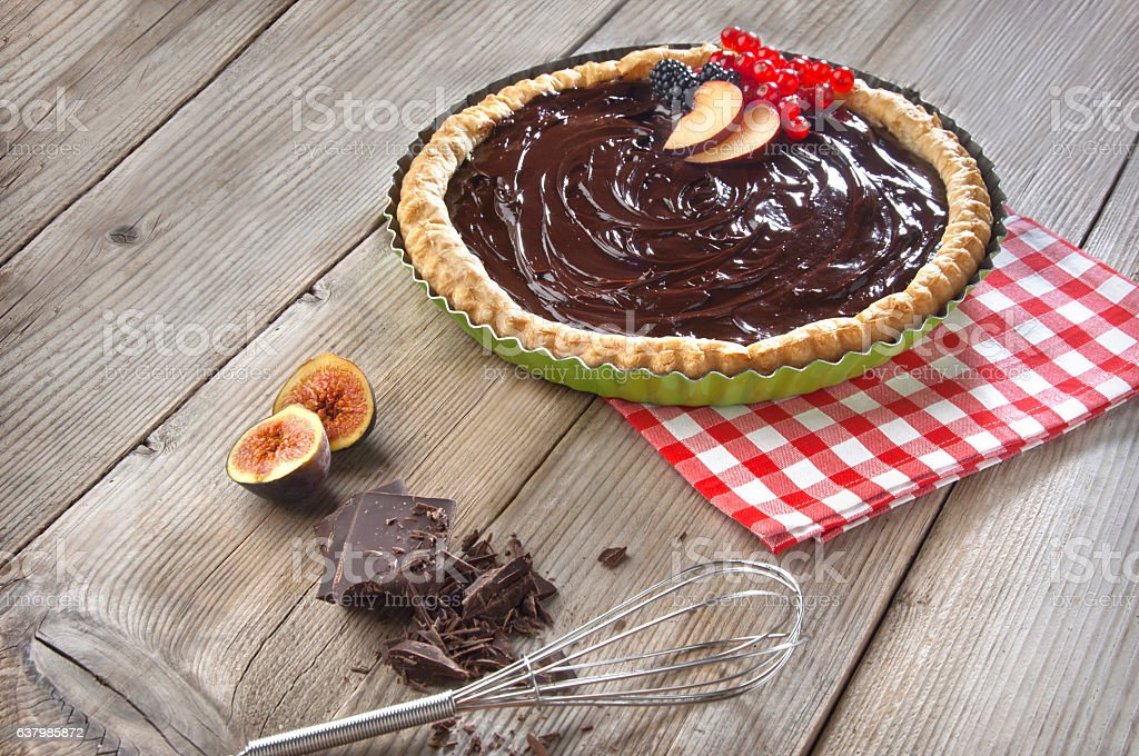 chocolate tart on a wooden table stock photo