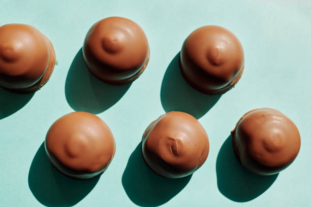 Chocolate Tea cakes against plain blue background, from above with strong shadows. stock photo