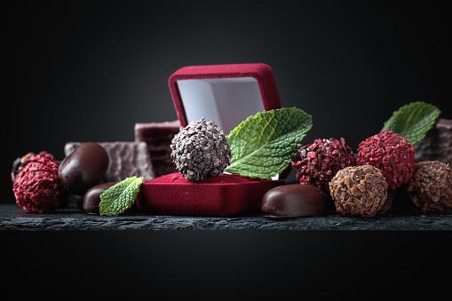 Chocolate truffle in red gift box.