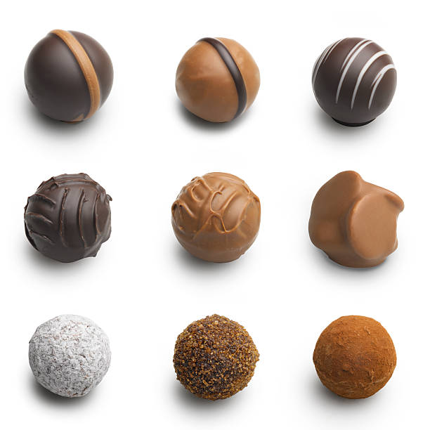 chocolate truffles assortment isolated on white stock photo