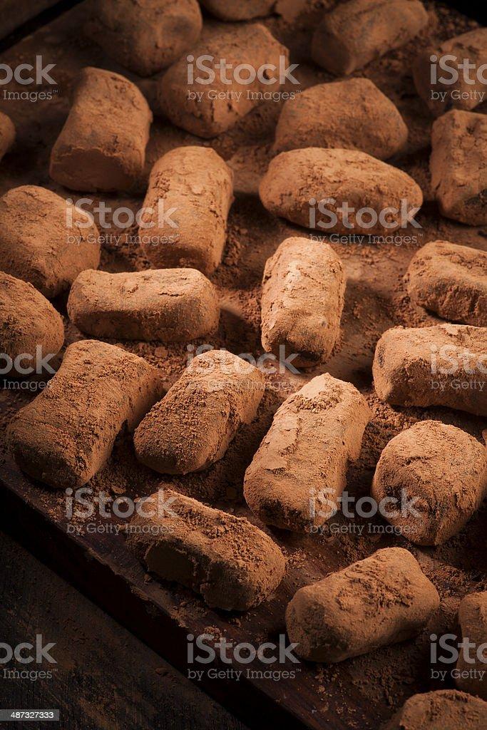 chocolate truffles in cocoa powder stock photo