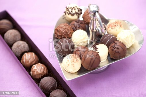 183269671 istock photo Chocolate truffles on metal tray and in a box 175437590