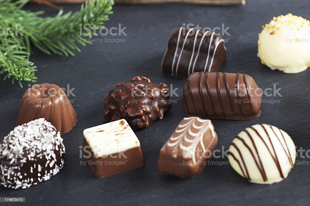 Chocolate truffles on slate with christmas decorations royalty-free stock photo