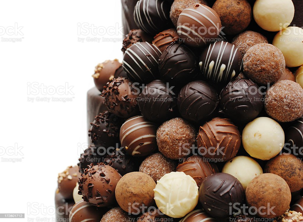 Chocolate truffles on the side of a wedding cake royalty-free stock photo