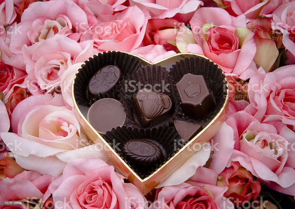 Chocolate Truffles, Valentine's Day Candy, Heart Shape Gift Box & Roses royalty-free stock photo