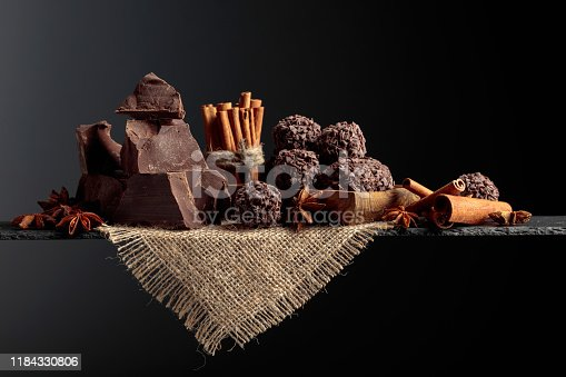 istock Chocolate truffles with broken pieces of chocolate and spices. 1184330806