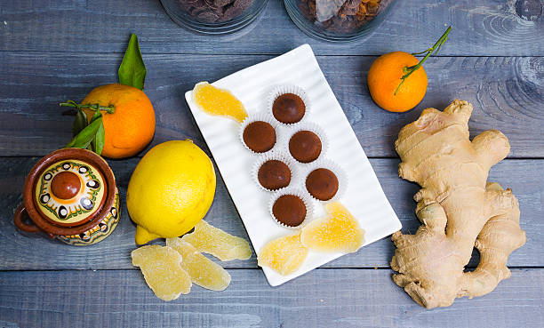 chocolate truffles with ginger candies in a gift box stock photo
