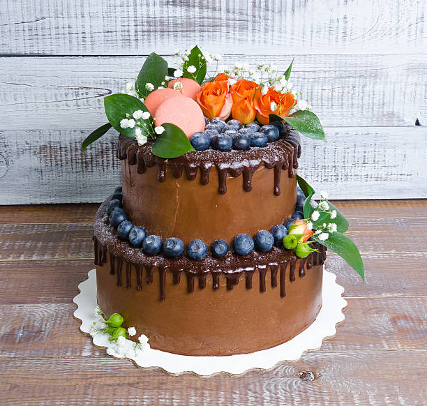 chocolate two layered wedding cake with roses stock photo