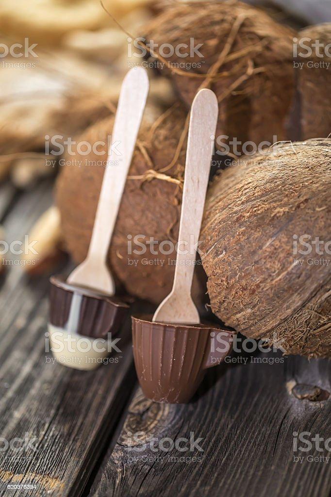 chocolate with coconut on wooden background zbiór zdjęć royalty-free