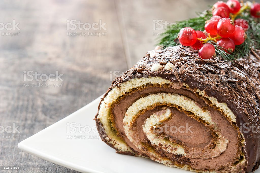 Chocolate yule log cake stock photo