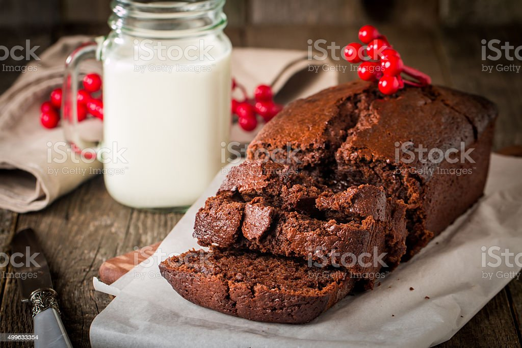 Chocolate-banana Loaf cake on paper stock photo