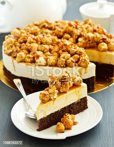 Chocolate-caramel cheesecake with popcorn.