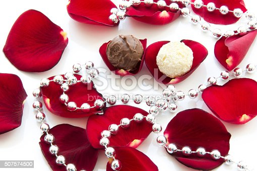 istock Chocolates among the rose petals. Valentine's day 507574500