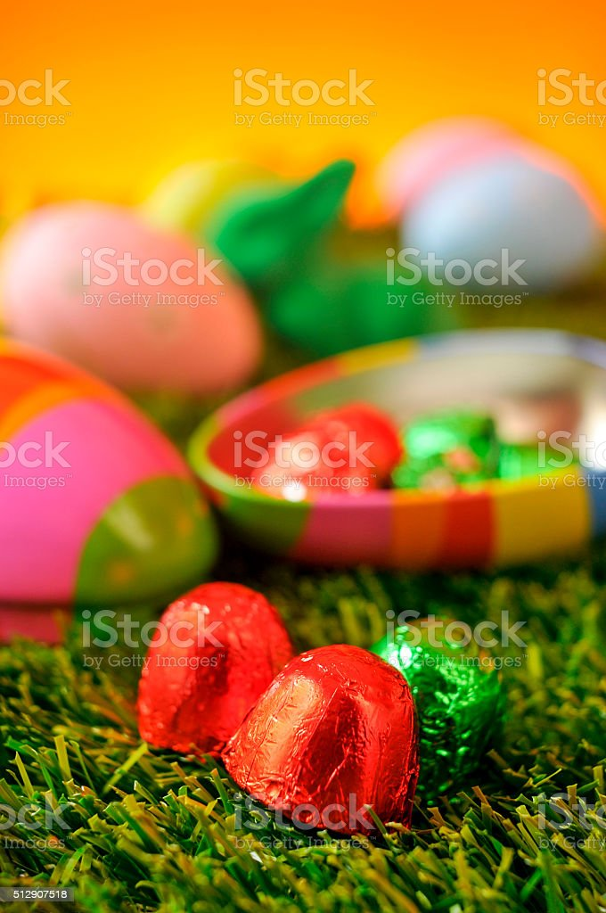 chocolates and estar eggs on the grass stock photo