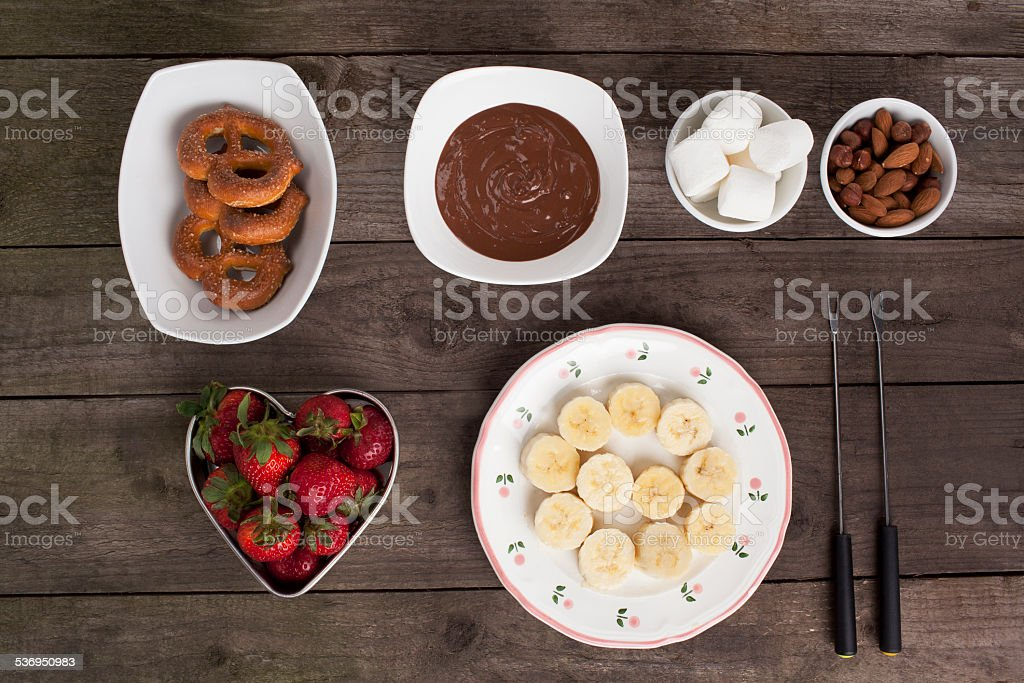 chocolates fruits and biscuits on the wooden table stock photo