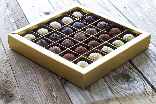 Chocolates in box on wooden – Foto