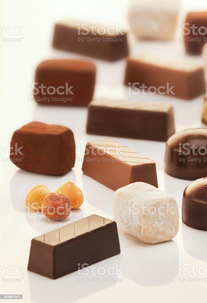 Chocolates of different types on white bachground royalty-free stock photo