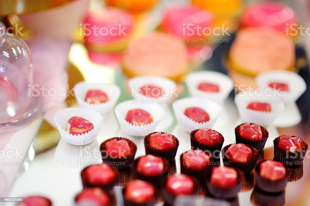 Chocolates on sweet table for wedding or birthday party stock photo