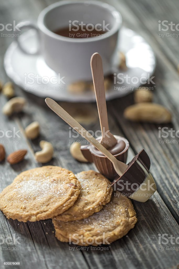 chocolates with tea and nuts on wooden background foto de stock royalty-free