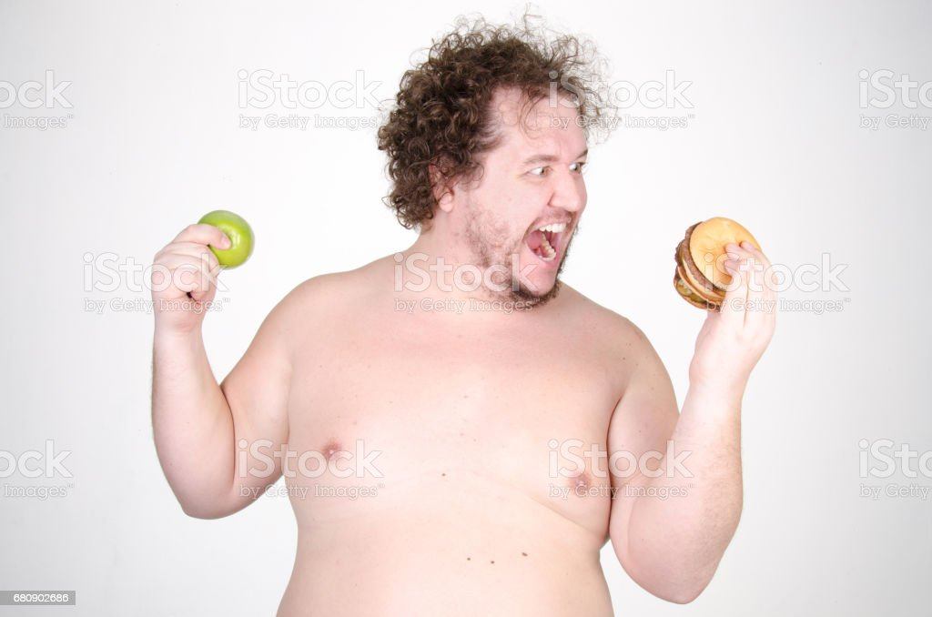 Choice. An Apple or a hamburger. The overweight guy. royalty-free stock photo