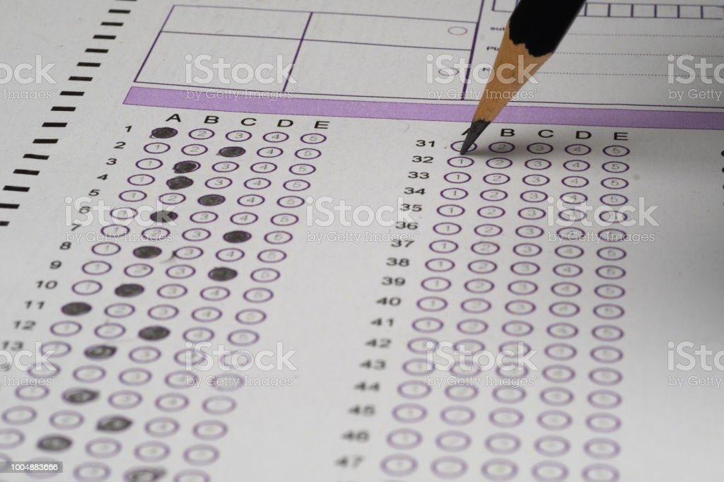 choice answer sheet and pencil stock photo