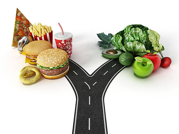 Choice between fast food and healthy food Road with a choice between fast food and healthy food. unhealthy eating stock pictures, royalty-free photos & images