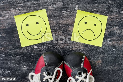 istock Choice - Happy Smileys or Unhappy. Sneakers before choosing 957140608