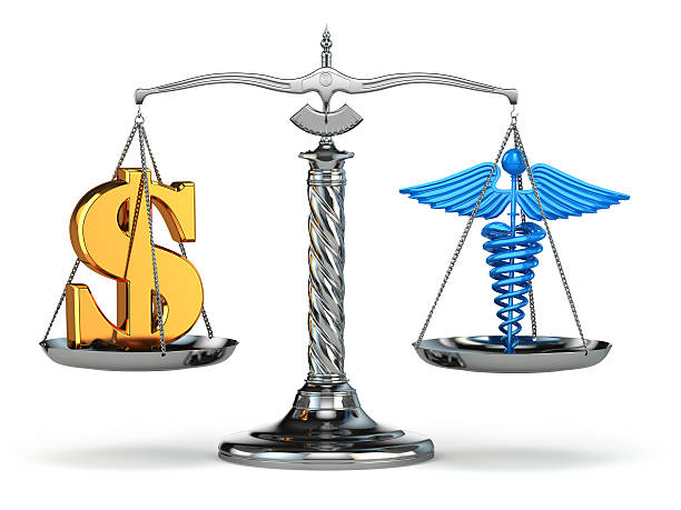 choice health or money. caduceus and dollar signs on scales. - caduceus stock pictures, royalty-free photos & images