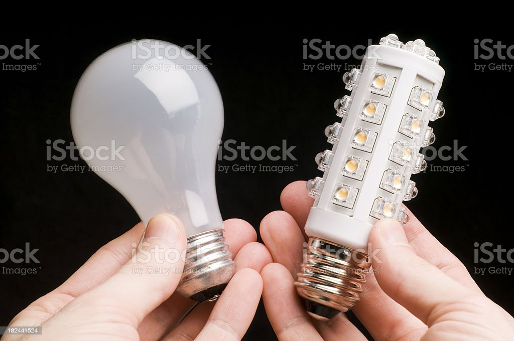 Choice of conventional or LED bulb royalty-free stock photo
