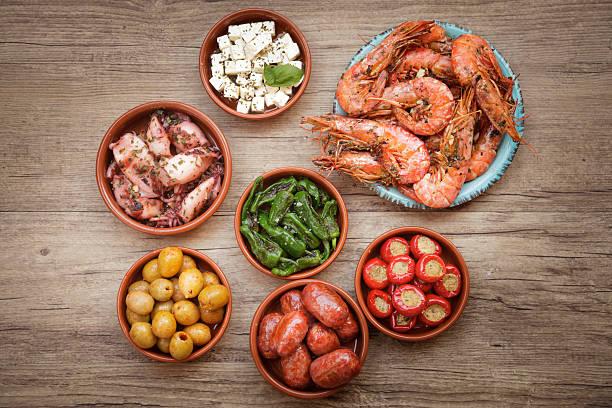 choice of tasty spanish tapas - tapas stock-fotos und bilder