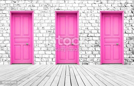 Three Doors On The Brick Wall