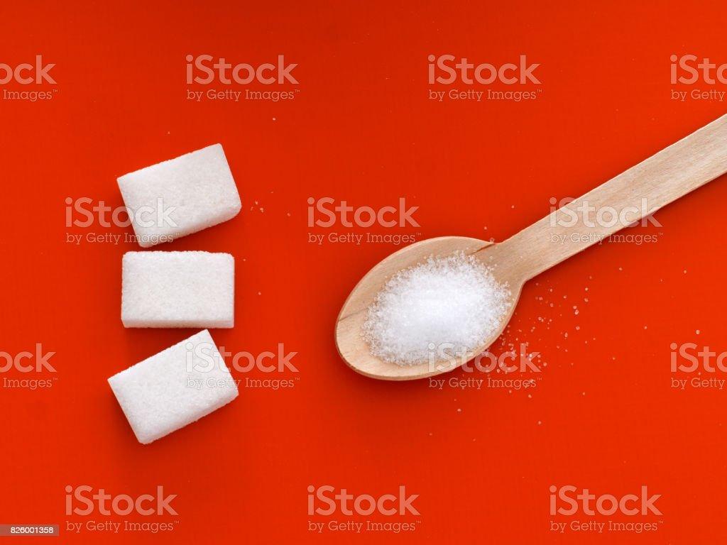 Choice - sugar or fructose. Orange background. stock photo