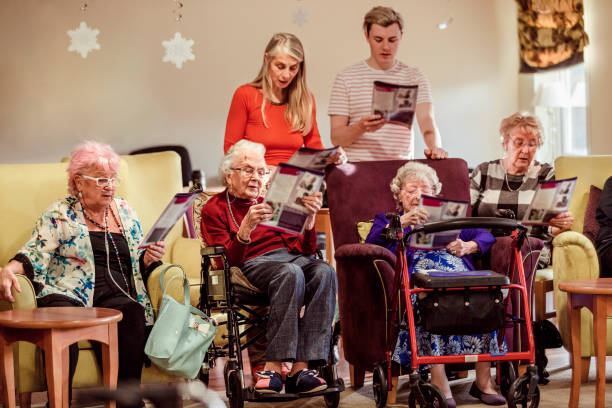 choir service amongst the elderly - full length of senior people singing together against white stock photos and pictures