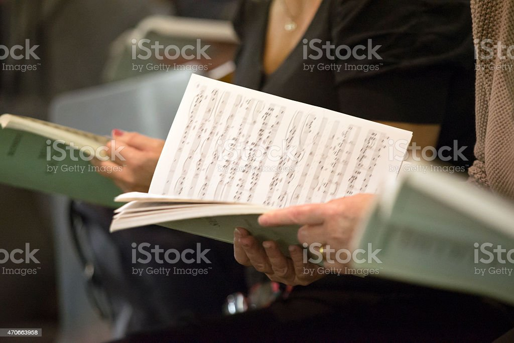 Choir singers holding musical score stock photo