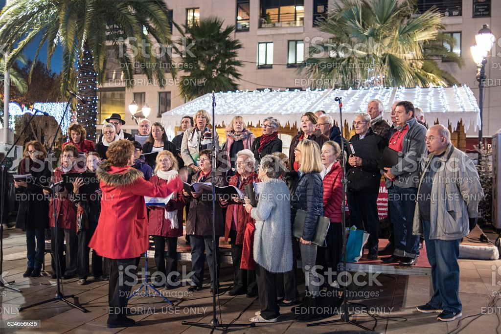 Choir singing carols in Christmas market stock photo