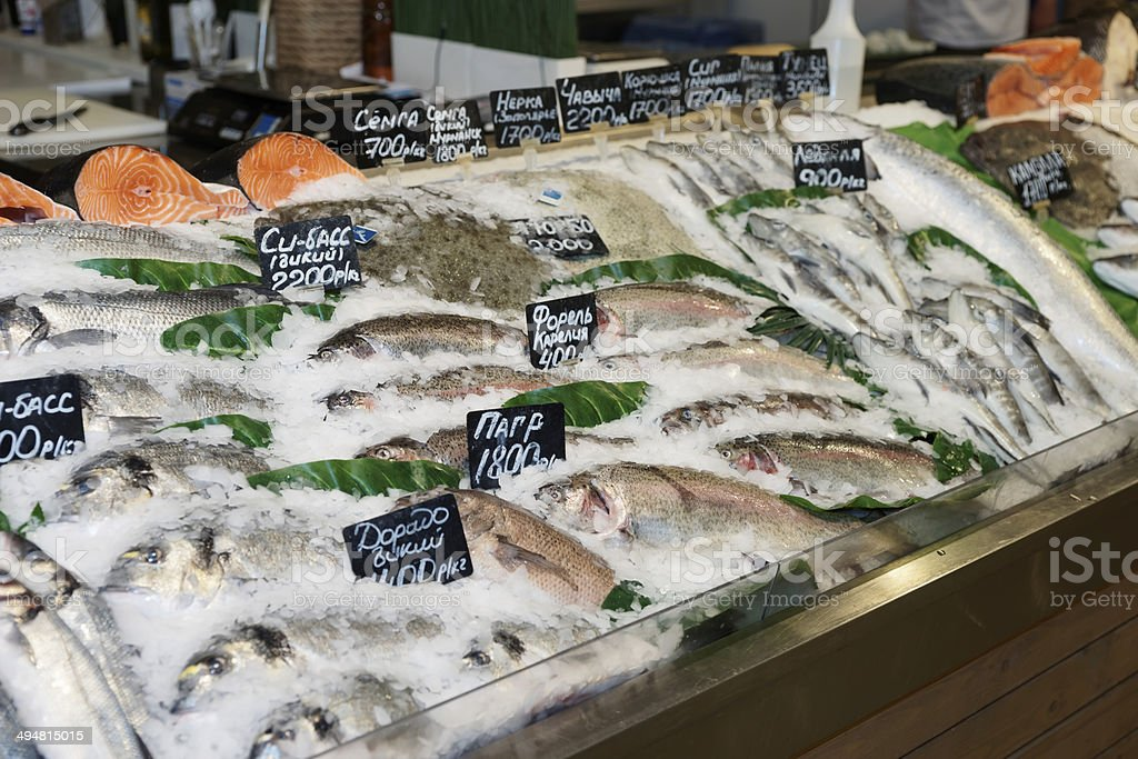 Choise of fish on market display stock photo