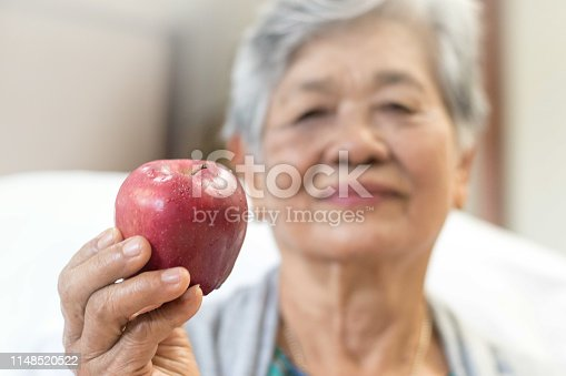 istock Cholesterol diet, diabetes control and healthy food nutritional eating for cardiovascular disease risk reduction for old people concept.Senior woman holding apples, super fruit. 1148520522