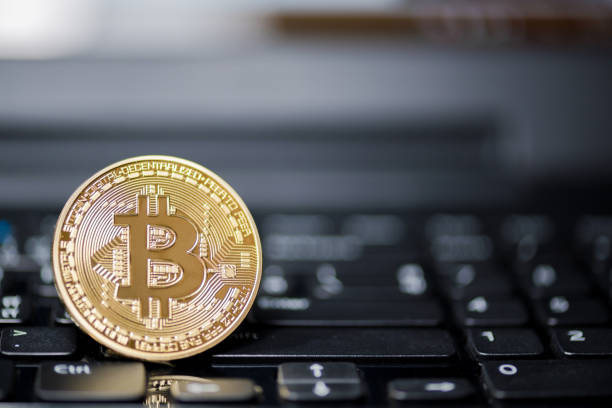 ChonBuri ,thailand - jul 17,2017: Golden Bitcoin money on computer. stock photo
