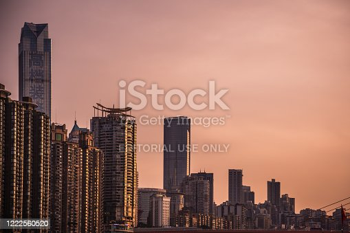 Chongqing, China -  August 2019 : View of the tall highrise residential and commercial buildings in the  Chongqing city at dusk