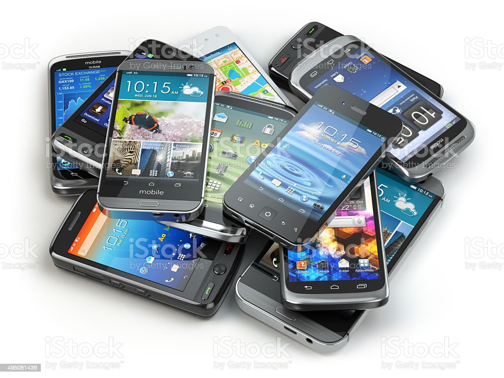 Choose mobile phone. Heap of the different smartphones. stock photo