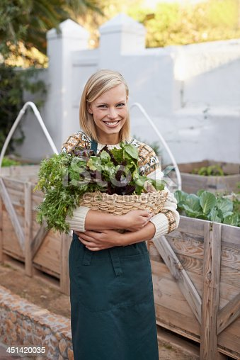 Portrait of an attractive young woman doing some vegetable gardening