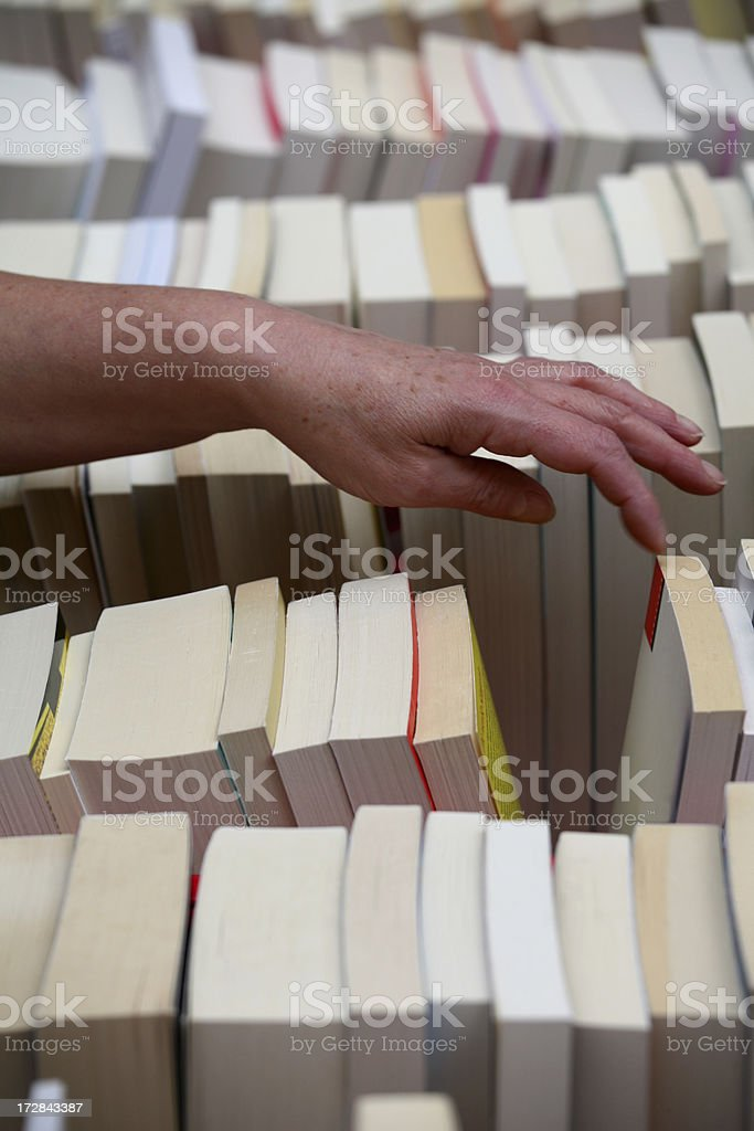 Choosing a book royalty-free stock photo