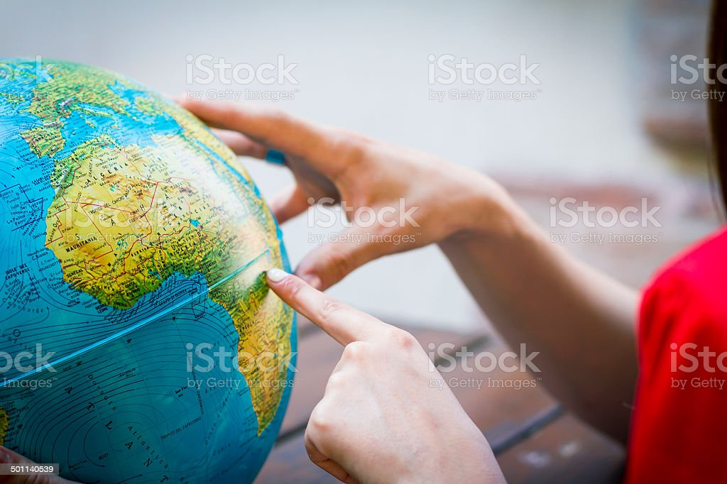 Choosing a place on Africa on globe stock photo