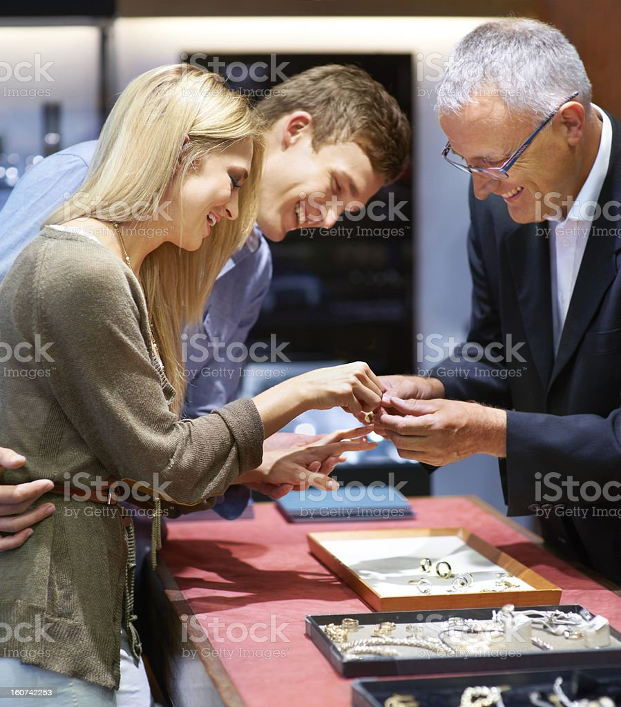 Choosing a ring which captures their love stock photo