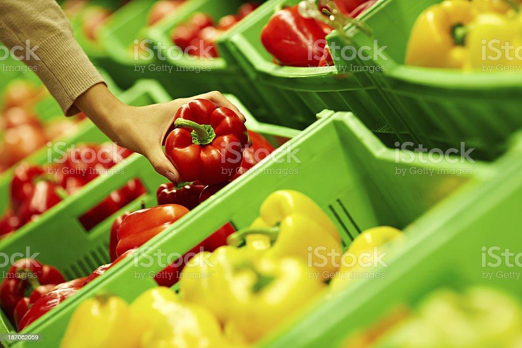 Choosing bell pepper royalty-free stock photo