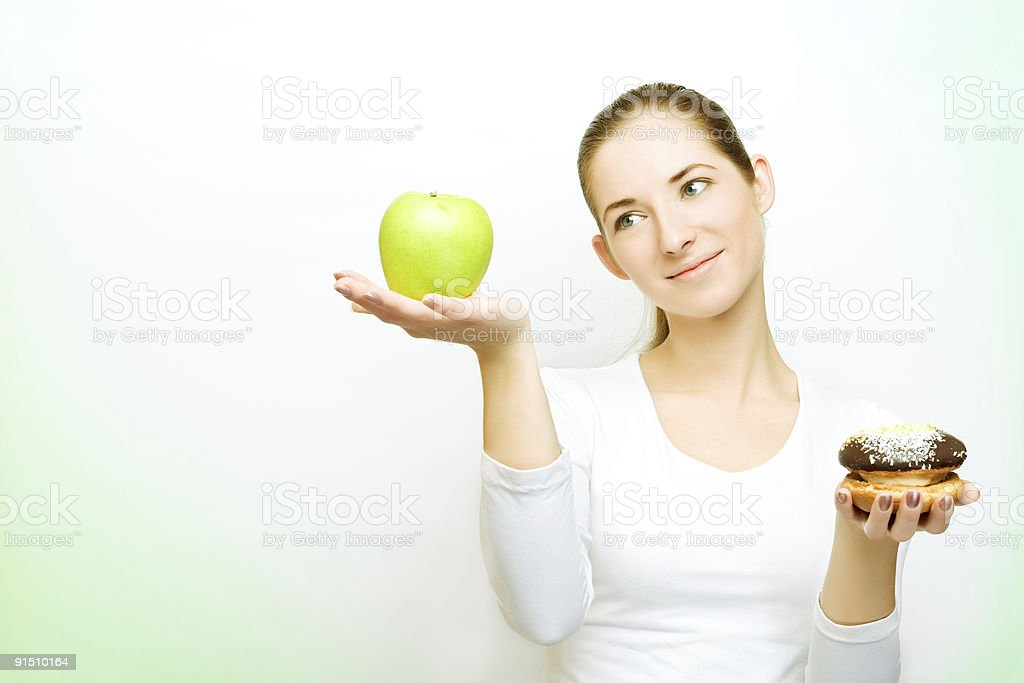 choosing between apple and cake stock photo